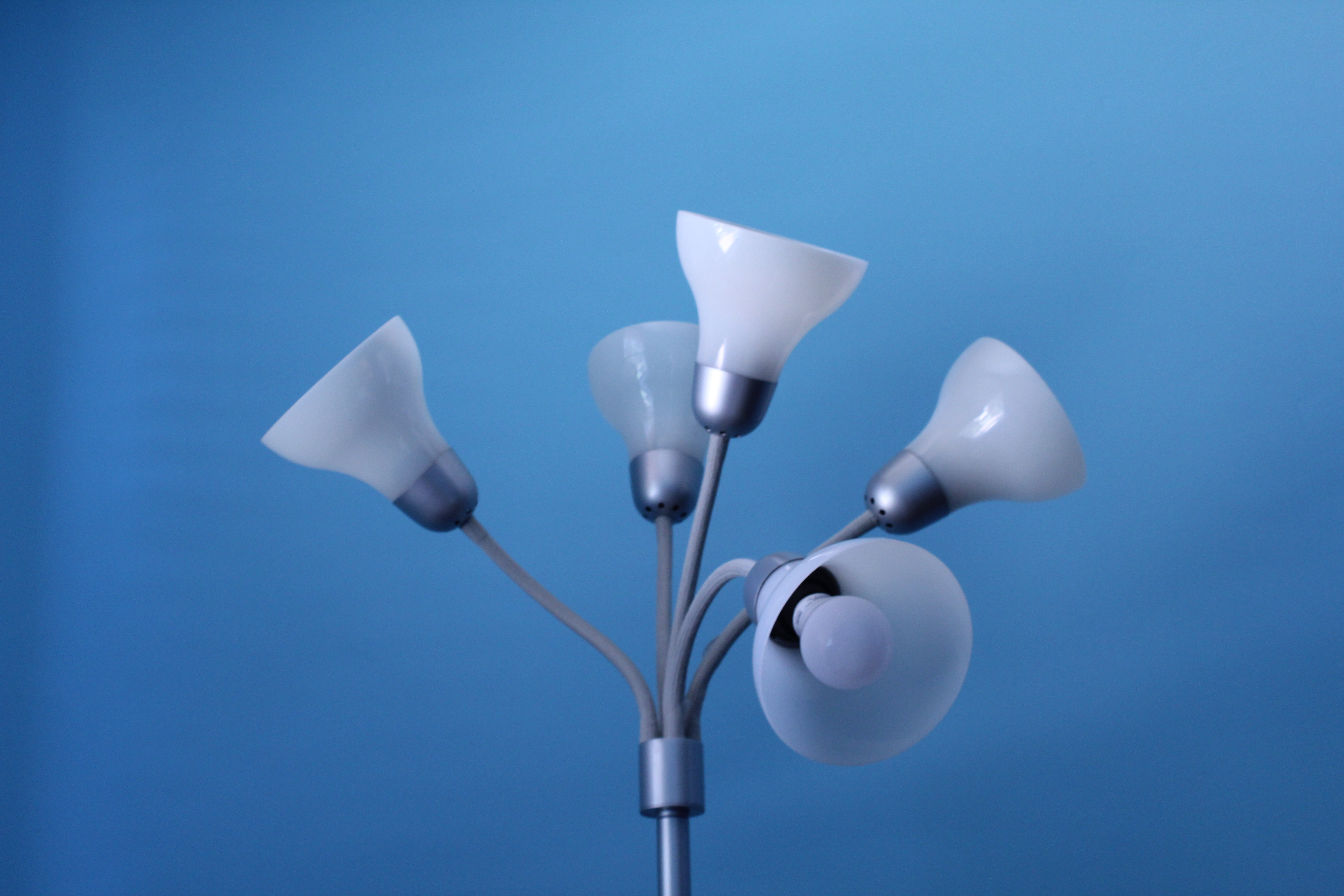 lamp with five lights in front of blue background