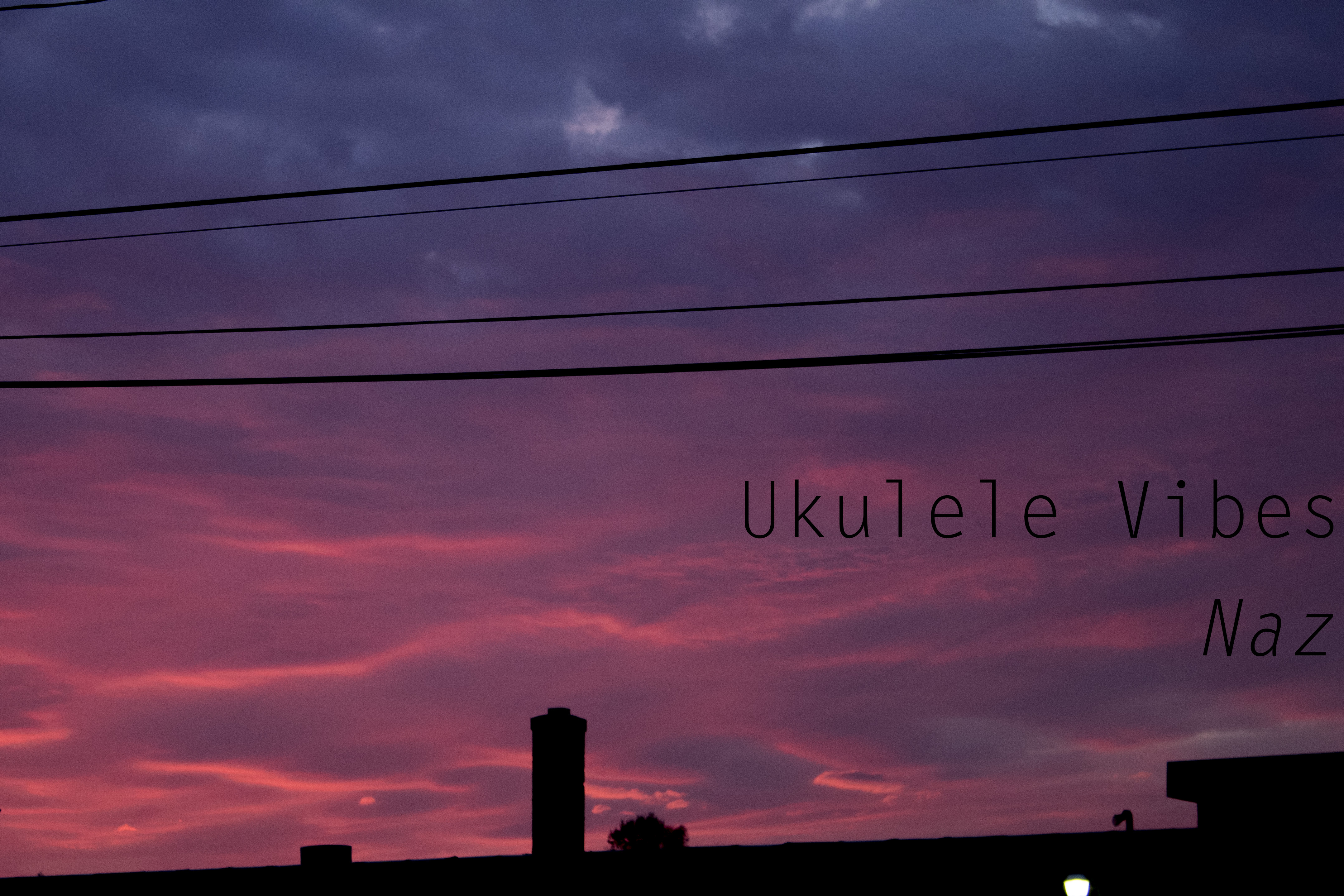 blue and pink sky with silhouette of houses at the bottom